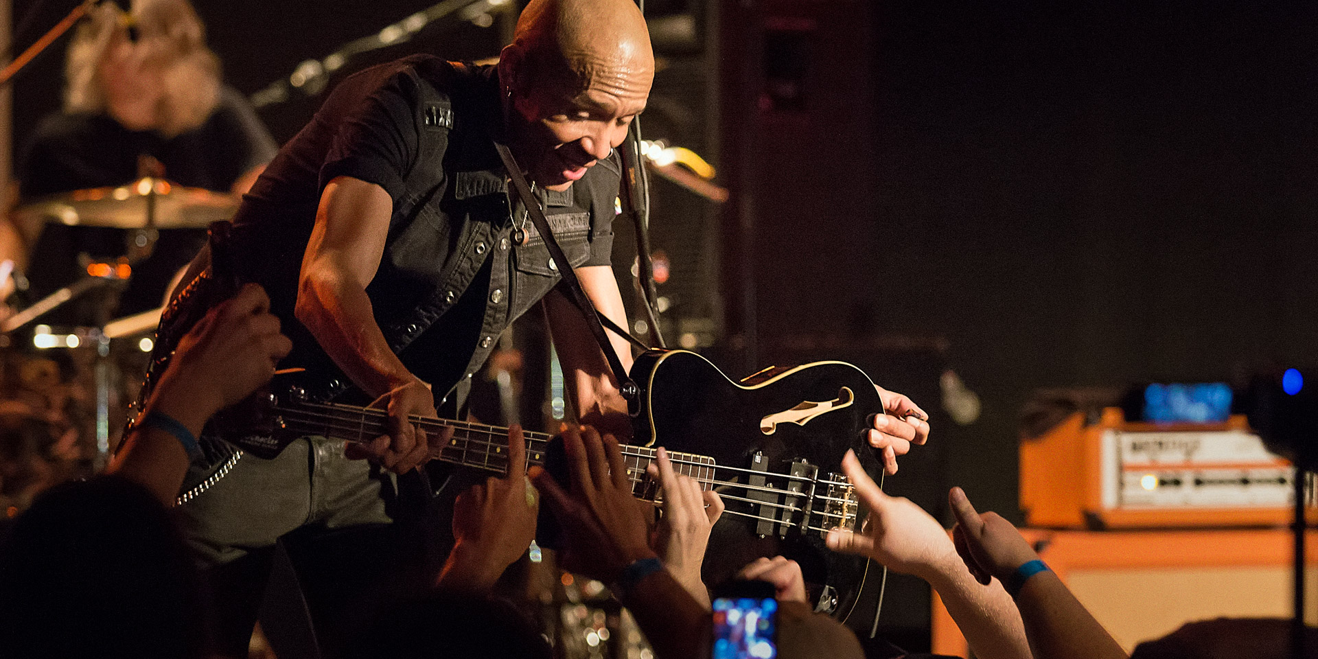 King's X: Crowd helps bassist Dug Pinnick play bass