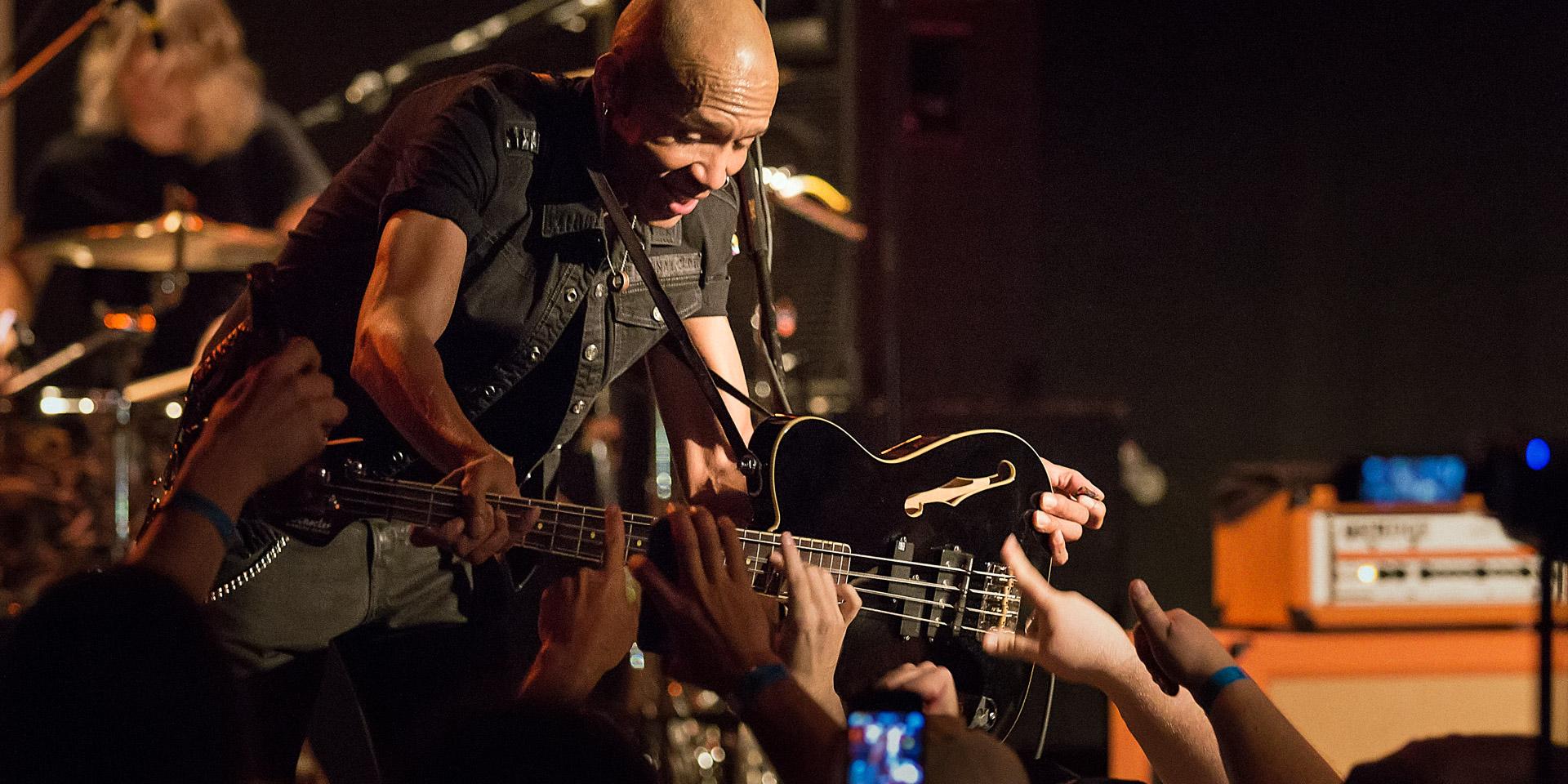 King's X: Crowd helps bassist Dug Pinnick play bass